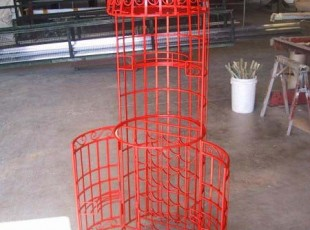 Powder coating has completely refurbished this wine cage.